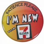 "7-11 Three Inch diameter Promotional Pin back Button with ""Patience Please - I'm New""n"