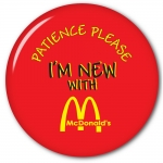 "McDonalds 2.5"" Promotional Pin back Button with ""Patience Please - I'm New""n"